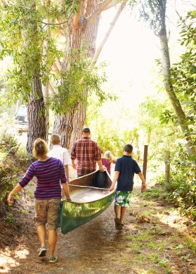 Family carrying Canoe